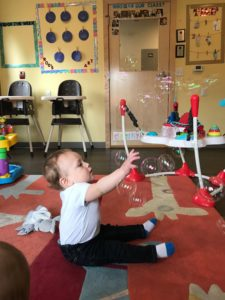 picture of child with bubbles at daycare