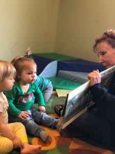 teacher reading to children at daycare